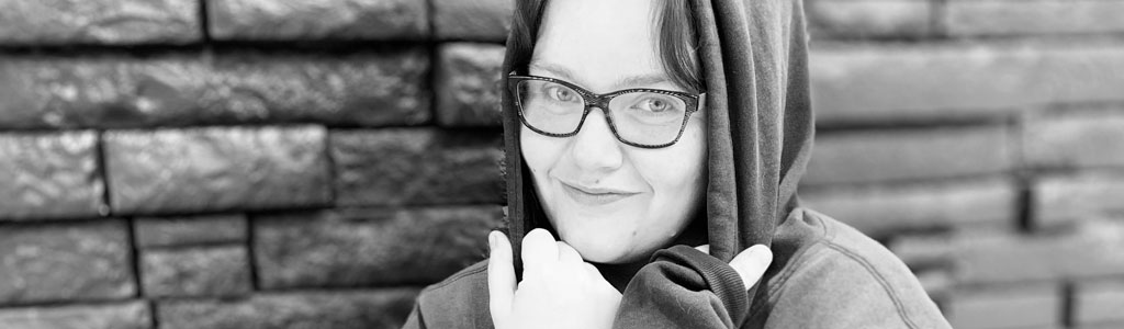 photo of smiling young woman in hoodie